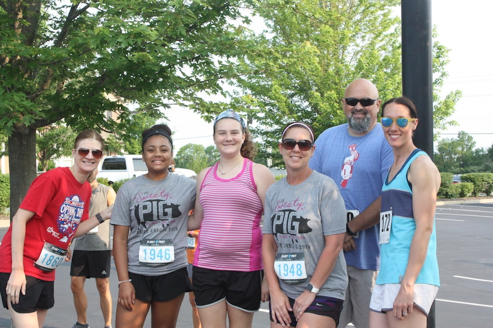 Six people gather after running in the Sweaty Pig race.